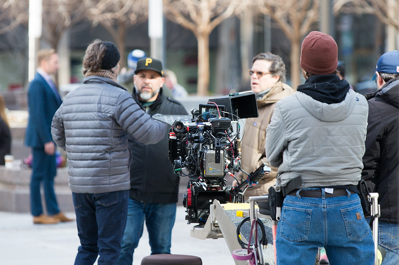 A movie being filmed in fron of Leadership Square in downtown Oklahoma City.
