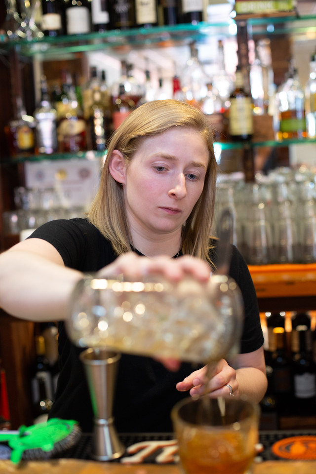 Alyssa Scott mixes a drink using Winship's Bitters at Picasso Cafe in Oklahoma City.