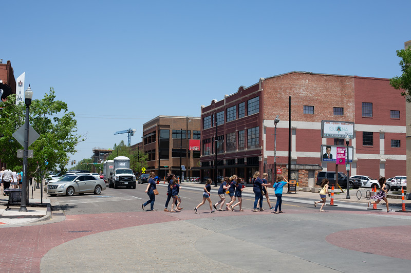 Pedestrians cross Broadway Ave on the eastern side of the MidTown District in Oklahoma City.