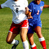 P-T photo | Steve Summers<br /> BALL BATTLE: Logansport senior Rachel Jennings (8) battles Kokomo's Cheyene Eltringham during semi final round of the IHSAA Girls Sectional Soccer tournament at Logansport High School Thursday.
