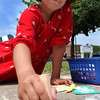P-T photos | Steve Summers <br /> WILD ART: Enjoying the afternoon sunshine and mild temperatures, Izzy Smith leaves her mark on the sidewalk during Celebrate Logansport day.