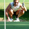 Chelsey Henn sizes up her putt.