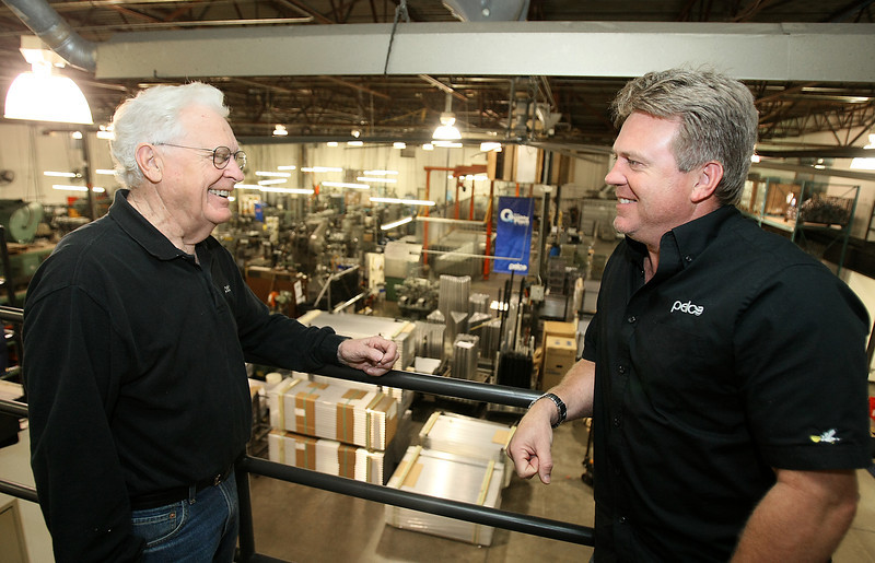 Phil and Steve Pardun, owners of Pelco in Edmond, overlooking the company's fabricating area Friday. PHOTO BY MAIKE SABOLICH