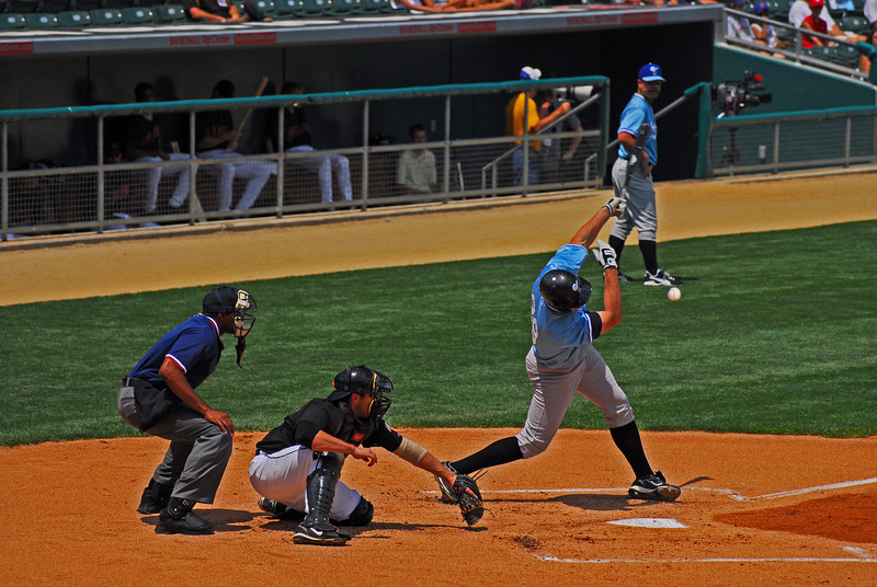 The batter stares down the ball, but the idea is to hit the ball...