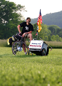 Liberty Rider, Michael Maresco poses at sunset in Pennsylvania on day 2 of his cross country journey from the Statue of Liberty to Alcatraz.