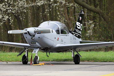 """This Belgian Air Force SF-260D Marchetti (ST-44, msn844) is seen parked on the Beauvechain flightline, wearing a special c/s on its tail to celebrate """"50 years of service in the Belgian Air Force""""."""
