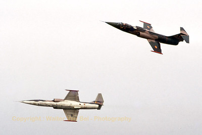 """""""The Slivers"""" - a Belgian Air Force demo team, using two F-104G's - in action, during the seventies."""