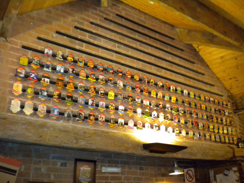 Allgates Beer clips arranged on the wall in the Bar