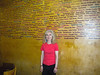 Liz posses next to the awesome beer wall in North Bar where they got every beer they've ever had carved into the wall