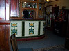 interior of the Lion Tavern showing the original tiles on the Bar