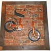 This really cool bike hangs on the wall as you enter through the door and <br /> <br /> head for the bar