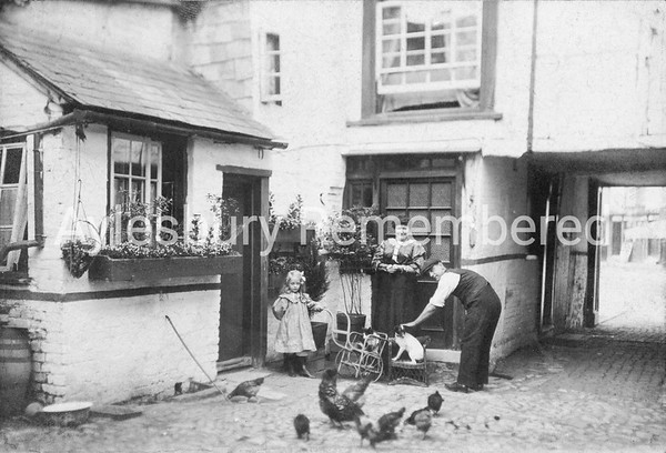 Sewell family in Red Lion yard, 1908