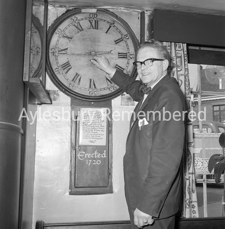 Old clock in Red Lion with Mr Thorpe, May 1965