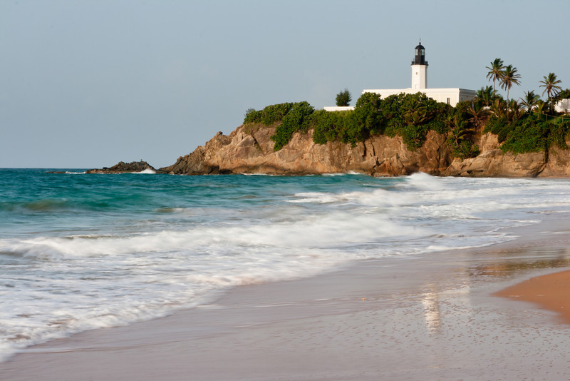 The reflection of the Manuabo Lighthouse can be seen on the remnants of the surf. Maunabo, PR<br /> <br /> PR-070727-0011
