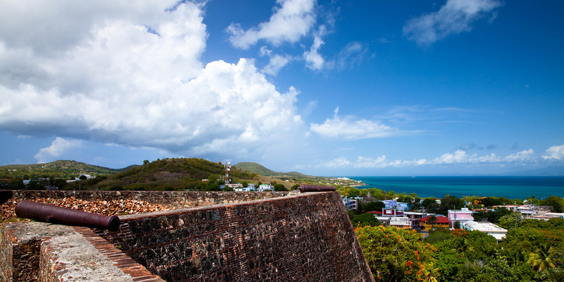 A cannon at Conde Mirasol fort overlooks the town of Isabel Segunda as if protecting it from enemies at sea. Vieques, PR<br /> <br /> PR-090812-0130