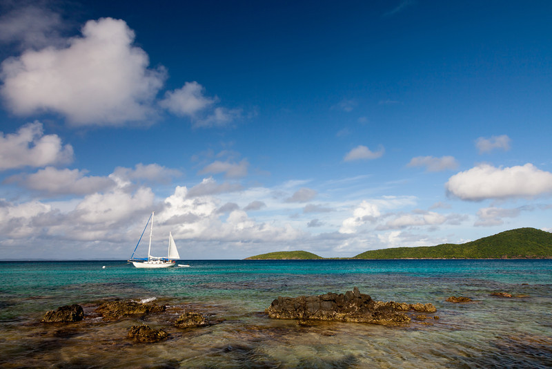 A sailboats is anchored on the waters near Playa Melones in Culebra. The nearby beach is full of coral pieces from the offshore reefs. Culebras, PR<br /> <br /> PR-110724-0025