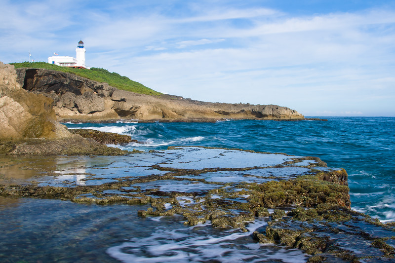 A small pool of water reflects the Arecibo Lighthouse. Arecibo, PR<br /> <br /> PR-070720-0069