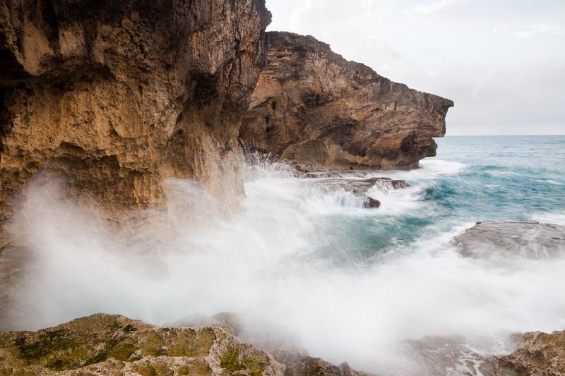 Waves break against the rock formations in La Cueva del Indio. Arecibo, PR<br /> <br /> PR-090805-0077