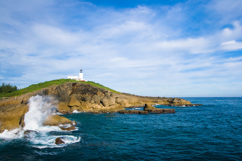 Powerful waves break against the rock formations near the Arecibo Lighthouse. Arecibo, PR<br /> <br /> PR-070720-0029