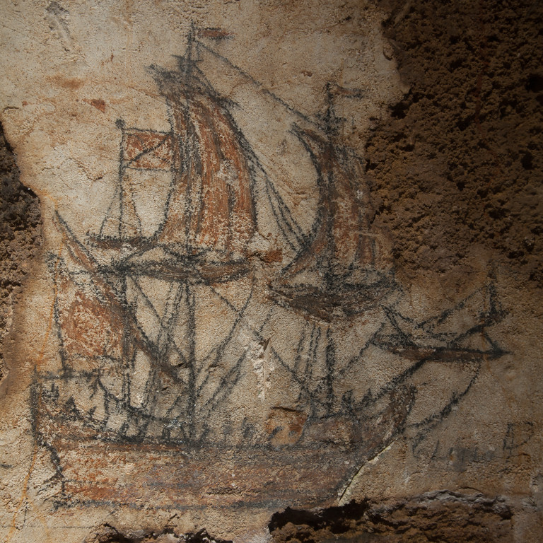 This drawing of a galleon is found in a dungeon of Fort San Cristobal. It is belief that is was made by a Spanish captain awaiting execution. There are 6 drawings like this on the wall. San Juan, PR<br /> <br /> PR-090804-0152