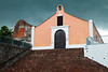 A summer storm moves over the Porta Coeli church. The church was constructed in the 18th century and now houses a museum. The ruins beside it are from a Dominican Order convent built in 1609. San German, PR<br /> <br /> PR-110728-0081
