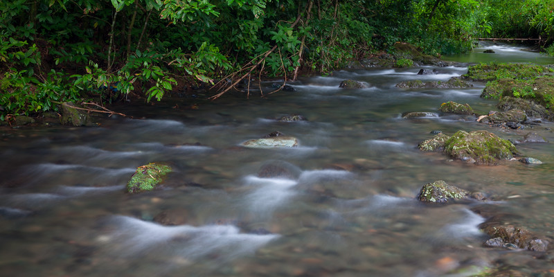 The town of Maricao resides in a lush green mountain range. This river runs just a short walk from it's town square. Maricao, PR<br /> <br /> PR-110729-0053
