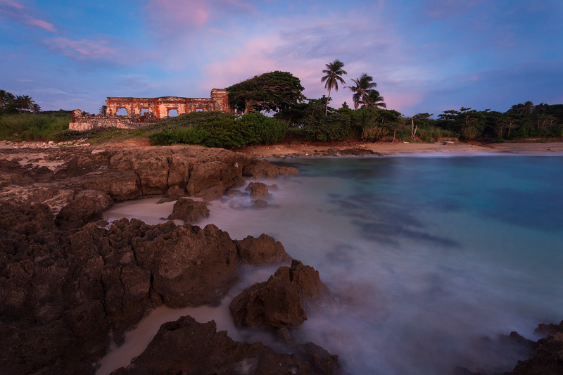 A passing storm leaves behind a spectacular sunset over the ruins of the old Aguadilla's Lighthouse. Aguadilla, PR<br /> <br /> PR-110727-0068