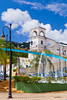 The town square in Yabucoa, Puerto Rico with decorative water fountain and church.