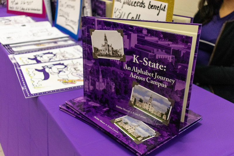 "Kansas State College of Education art students sells coloring books and ""K-State: An Alphabet Journey Across Campus"" books to local community members. The coloring books were drawn by a College of Education alumni and the books were written by the dean of the College of Education, Debbie Mercer and Lotta Larson. (Brooke Barrett 