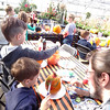 The main greenhouse at Griggs Farm was full of children painting their pumpkins. -- photo by Mary Leach