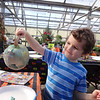 Damien LaFountaine, 5, of Billerica, proudly displays the pumpkin he painted at Griggs Farm. -- photo by Mary Leach