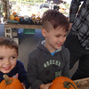 Camden Keplinger, 4, and Aidan Keplinger, 6, both of Billerica, gleefully select their pumpkins. -- photo by Mary Leach