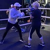 Legendary boxer Irish Micky Ward boxes with Parkinson's patient Cathy Wesalowski of Norfolk.<br /> COURTESY RYAN ROACH