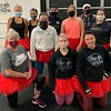 The Box2Burn fighting divas don red tutus, with owner/trainer Sean Eklund and Irish Mickey Ward in back.
