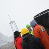 """Some kind of debate about how to find the pumpkins in all the fog and snow I think. The GPS systems weren't working, and Brian of Team """"not in my dirveway"""" apparently hit the spotters with a pumpkin. :) hehe"""