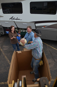 Lloyd, Willy, Diane and Greg loading pumpkins into the RV