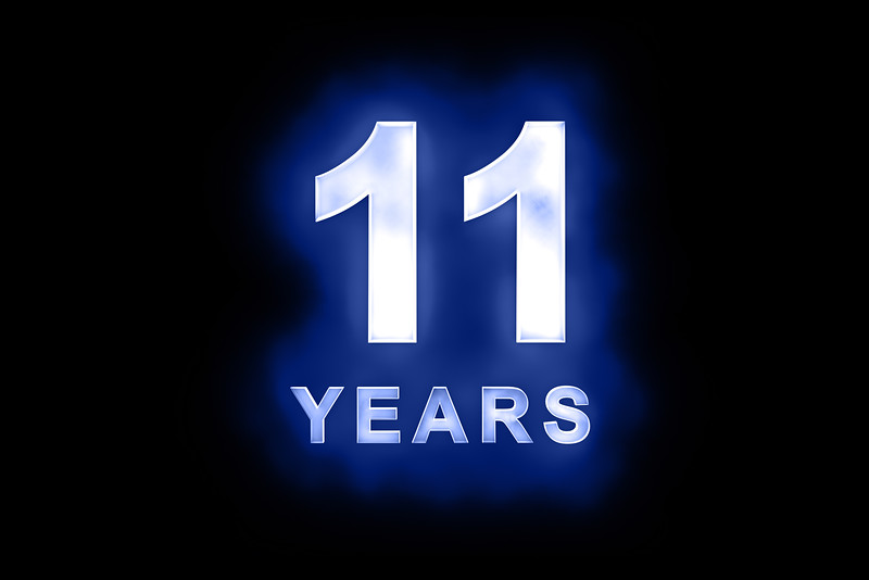 11 Years in glowing white numbers on blue