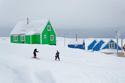 Inuit children exercising skiing
