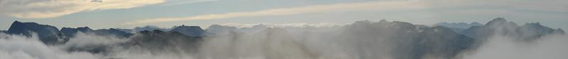 Fog lifting over Eisenerzer Alpen, seen from Brandstein, Hochschwab