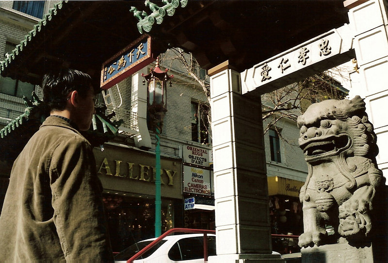 My friend Ari posed with the Chinese lion at the entrance to China Town on Grant St. in SF.