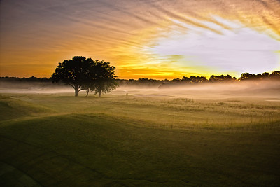 Sunrise over the driving range. This image always makes me hear the Lion King music in my head.