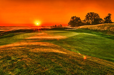 Sunrise over 15 green.