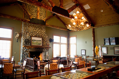 The lounge at Purgatory Golf Club, wild animal heads, Old Hickory furniture, and a roaring fire. What else do you need?