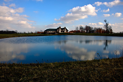 A beautiful day at Purgatory Golf Club, viewing the club house from across the lake.
