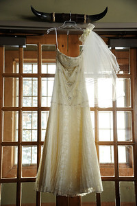 Let's see, how many places can you hang a wedding dress and get a good, or better yet great picture? Apparently, quite a few at Purgatory Golf Club.