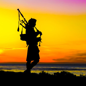 Sunset bagpipes are played every night at Spanish Bay in Monterey California. I found it got better every night. By the third night, I had tears in my eyes as I captured this image.