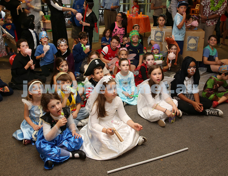Chabad Of The North Shore Purim Party. Children watch a bubble show.