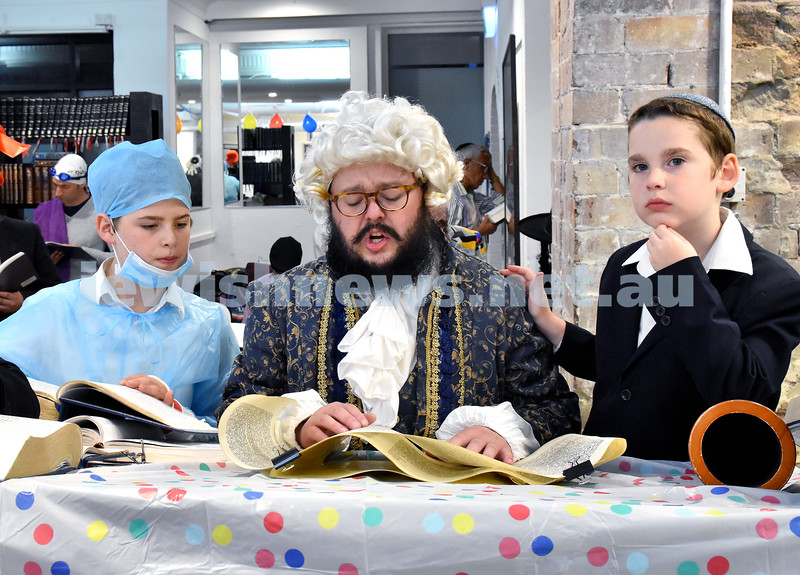 Purim at Nefesh. Reading Megilat Esther: From left: Mendel Sufrin, Rabbi Chanoch Sufrin, Gavi Sufrin. Pic Noel Kessel