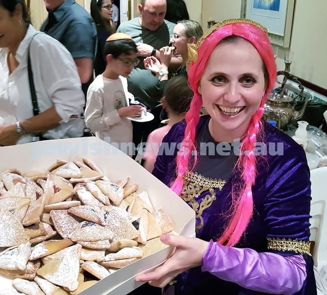 Purim at Nefesh. Nechama Dina Moss sharing hamantashen. Pic Noel Kessel