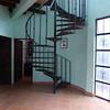 doors on left lead to downstairs bedroom and bathroom. Glass doors lead to patio/walkway to laundry/studios.